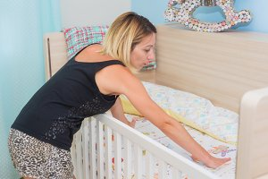 Young woman making her baby crib