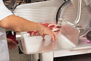 butcher cutting meat in the butchery