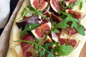 Pizza or flatbread with figs and ham