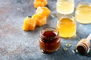 Honey, honey dipper and honeycombs