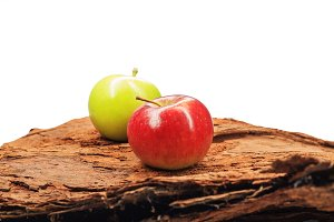 apples on the tree bark isolated on