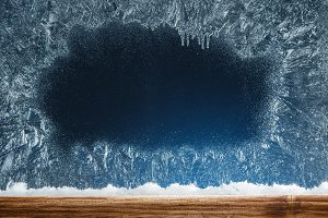 Wooden sill and frozen window. Chris