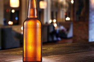 Frosty bottle of light beer on the b