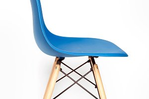 Blue modern chair with wooden legs