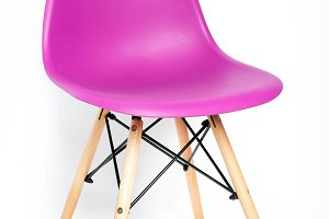 Pink modern chair with wooden legs
