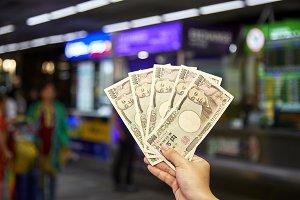 hand businesswoman catching yen