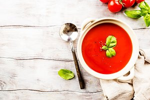 Tomato soup on wooden table