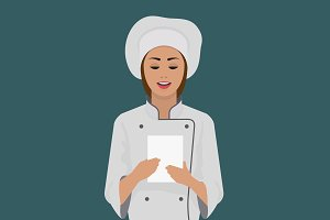 Girl cook keeps a piece of paper