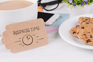 "Paper card with ""business time"" text"