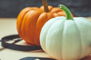 Autumn orange and white pumpkins wit