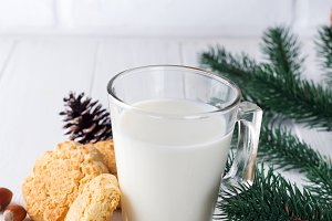 A stack of cookies and glass of milk
