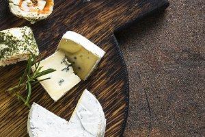Cheese platter on dark stone table.