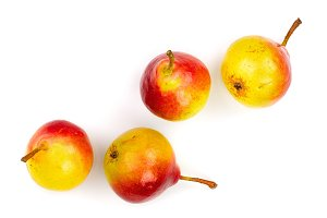 four ripe red yellow pear fruits
