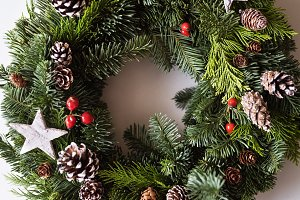 A christmas wreath on a white