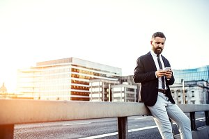 Hipster businessman with smartphone