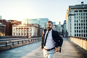 Hipster businessman running on the