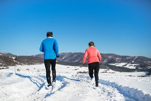 Rear view of senior couple jogging