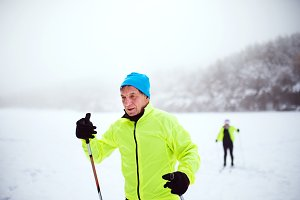 A senior couple cross-country skiing