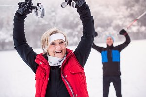 A senior couple cross-country skiing