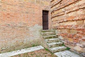 Door in the corner of brick walls