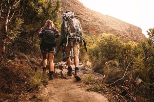 Friends with backpacks hiking