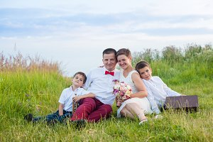 Romantic family in the field in the