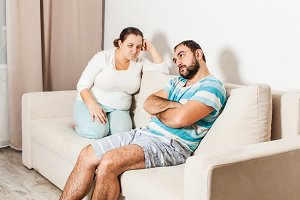 Couple sitting on couch at home in