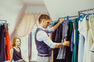 Husband helps to choose dress for
