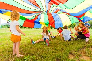 Funny games under colorful canopy in