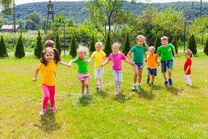 Runnig children at summer camp in