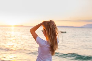 Woman facing sunrise in front of the