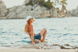The sexy model on the beach, sunny