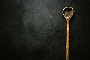 Old spoon on dark table