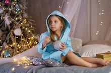 Little girl in bathrobe. Christmas
