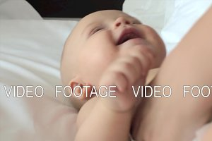 Baby laughing when mother making