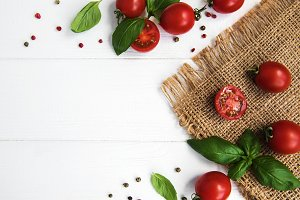 Cherry tomatoes and green basil