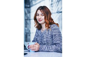 young woman drinking coffee at a