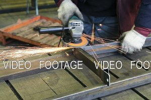 Worker cutting steel with angle