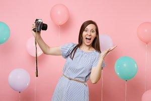 Portrait of surprised happy woman in