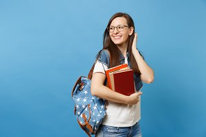 Young pretty cheerful woman student