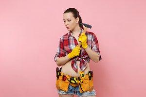 Strong young handyman woman wearing