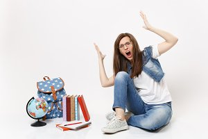 Young shocked angry woman student in