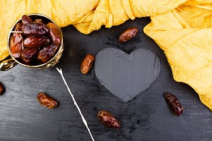Dry fruit dates in golden cup near s