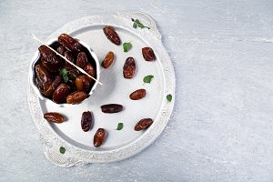 Dry fruit dates on silver tray. Copy