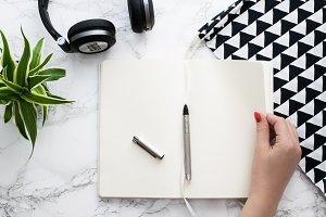 Modern desk hands in frame