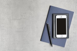 Phone & Notebooks Flat Lay