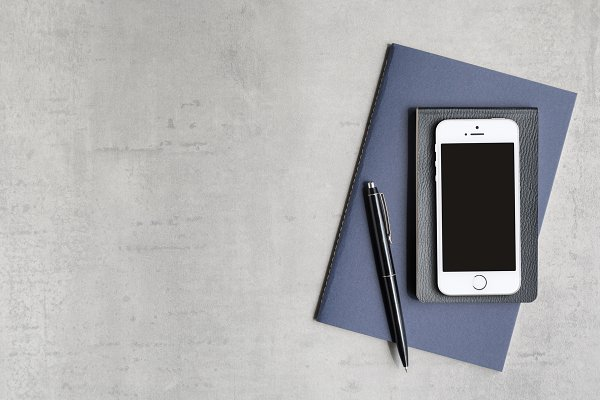 Phone & Notebooks Flat Lay