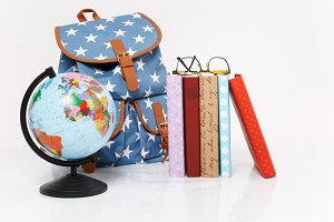Close up of globe, blue backpack wit