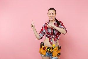 Young smiling handyman woman in shir