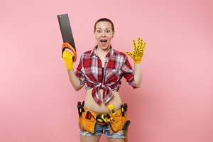 Strong young handyman woman in plaid